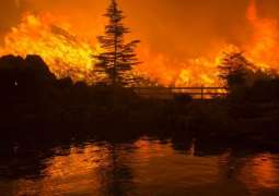 California forest fire, killing one person, destroyed 20 houses