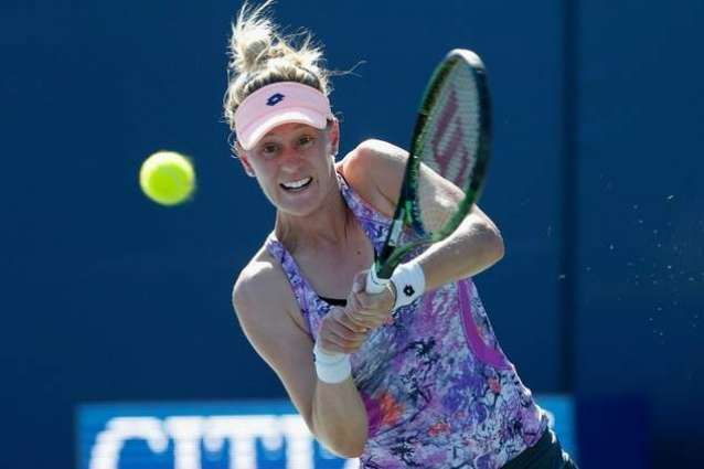 Tennis: Riske rallies to advance at Stanford