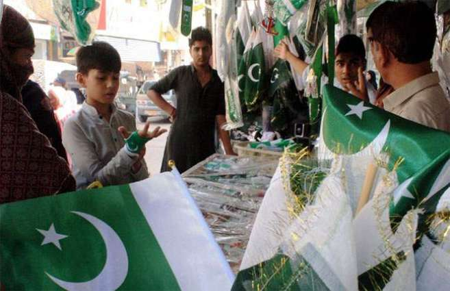 Vendors set up colorful stalls of national flags, banners