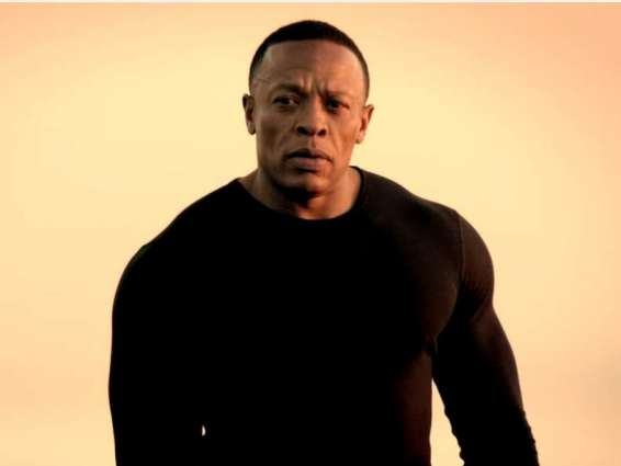 Rap tycoon Dr. Dre handcuffed outside home