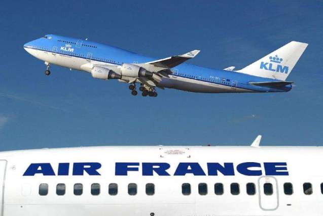 Air France-KLM cuts loss, warns of attacks impact