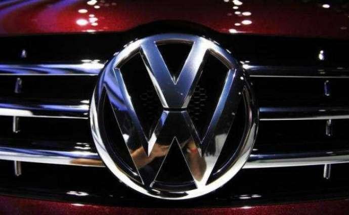 Volkswagen says net profit falls 57% in second quarter
