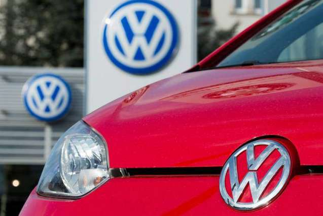 Volkswagen says net profit falls 57% in second quarter