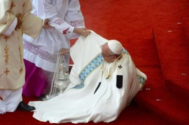 Pope Francis falls in Poland, escapes injury