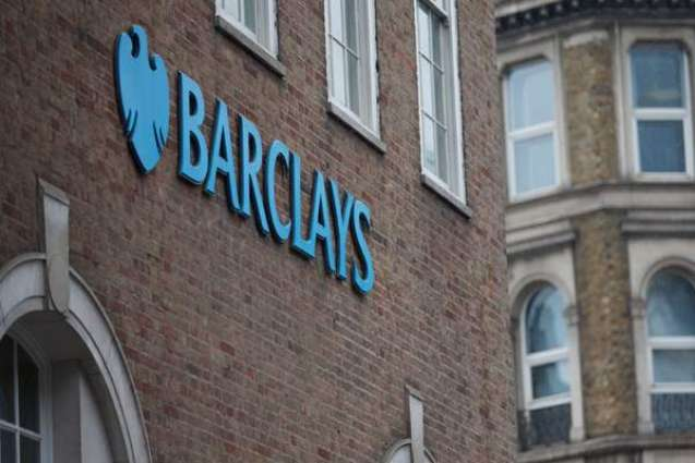 Barclays posts sliding first-half profits