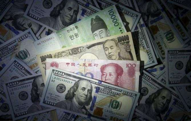 Emerging currencies soar as US rate hike talk fades