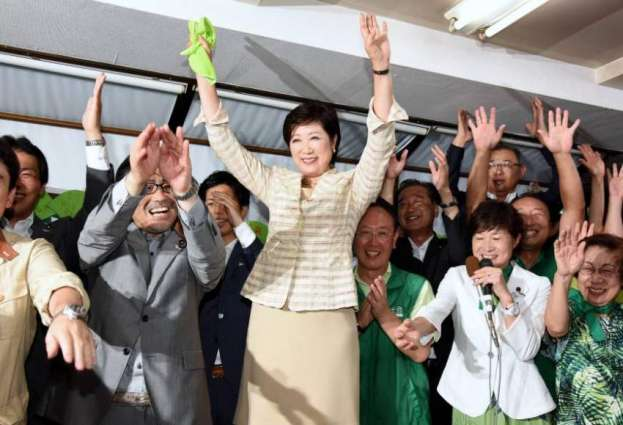 New Tokyo governor says defying party secured win
