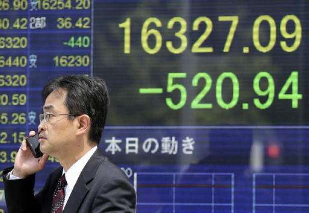 Tokyo shares hit by slide in oil prices