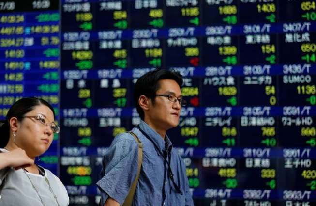 Tokyo shares down by break after rally fizzles
