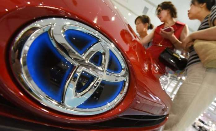 Toyota Q1 net profit down, cuts FY forecast on yen rally