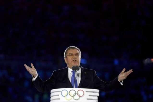 Olympics: IOC chief urges unity in 'world of crises, mistrust'