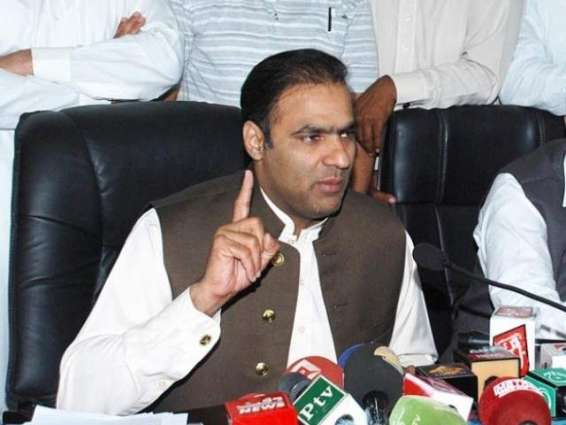 Abid Sher presents compensation cheques to victims' families