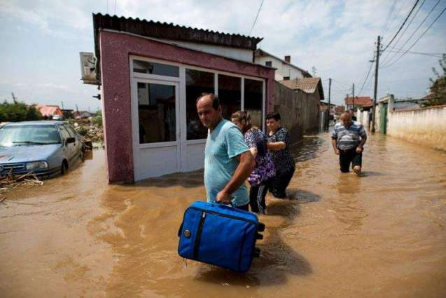 Macedonia mourns after storms kill 21