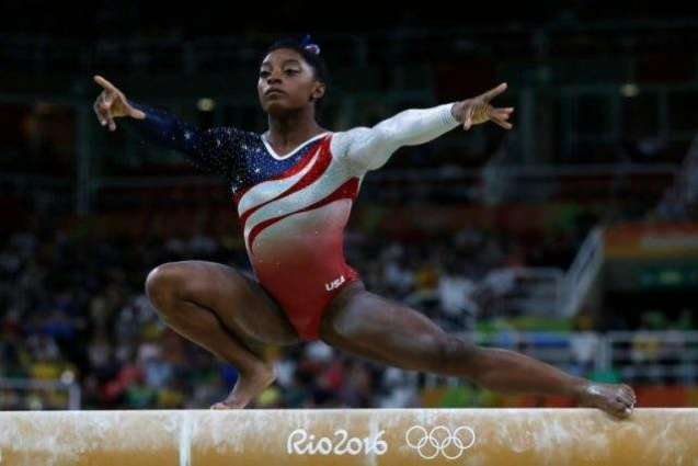 Olympics: Biles powers USA to gymnastics team gold