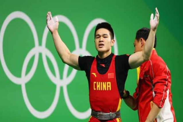Olympics: China's Shi wins men's 69kg weightlifting gold