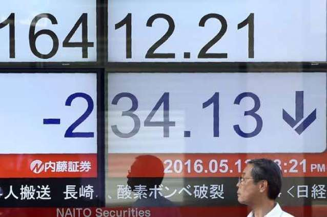 Tokyo stocks down by break as strong yen hits exporters