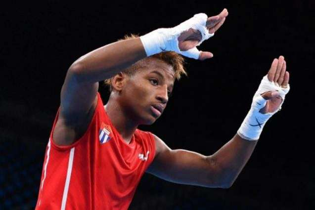 Olympics: Cuban boxing prodigy secures first medal