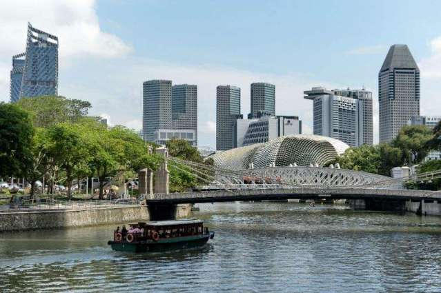 Singapore cuts 2016 forecast as world economy slows