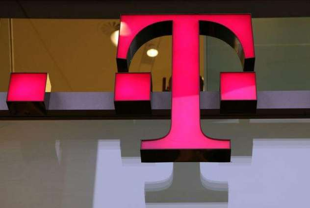Deutsche Telekom sees profits fall on big charges