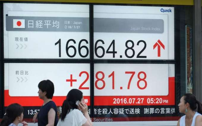 Tokyo shares rise after Wall Street gains