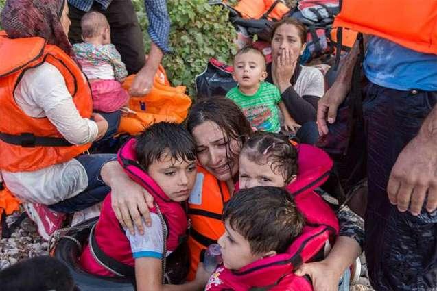 UN chief urges all countries to help refugees & migrants -- build bridges, not walls