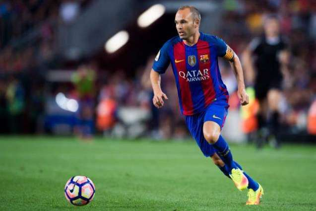 Football: Iniesta out with knee injury