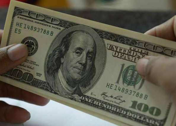 Dollar slumps ahead of Fed meeting minutes