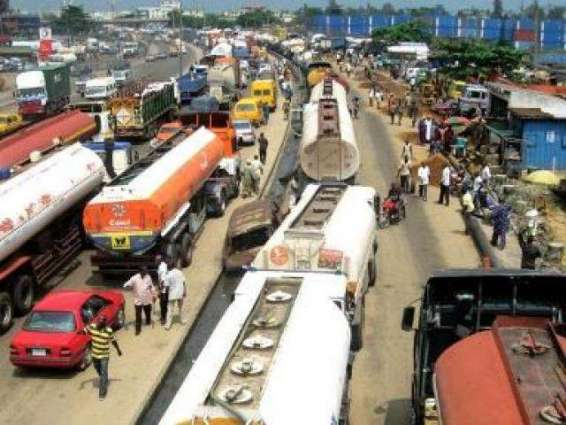 Long vehicles parked along main road pose fatal accidents' threat
