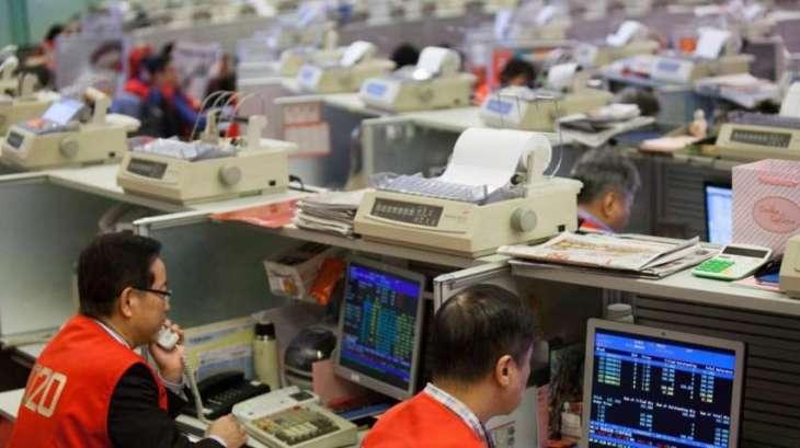 Shanghai stocks slip at open, Hong Kong up