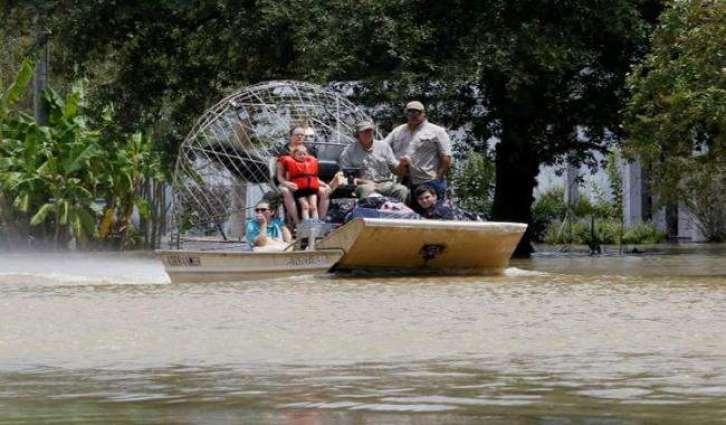 Eight dead, 40,000 homes flooded in Louisiana