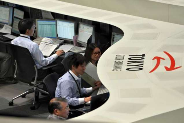 Tokyo shares end higher on energy firms, exporters