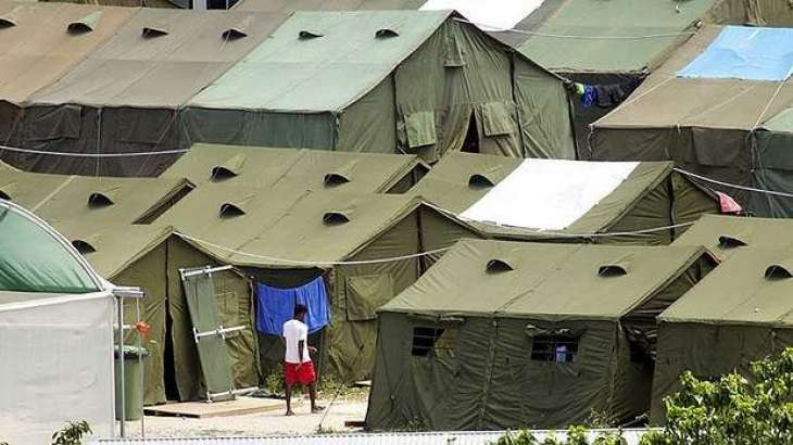 PNG says Australia agrees to close immigration camp
