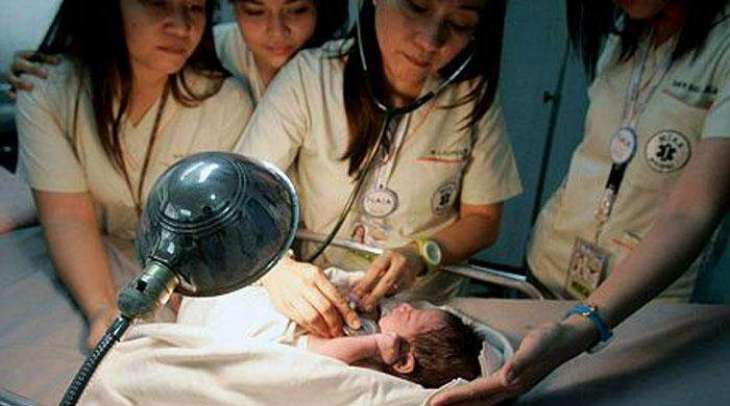 Baby girl born mid-air on flight to Philippines