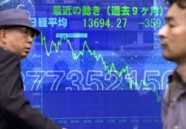 Tokyo shares open down as stronger yen hits exporters