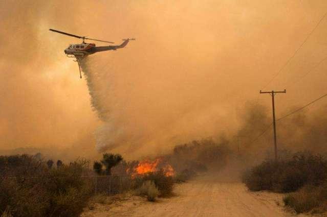 Firenadoes rage in California as blaze menaces 82,000