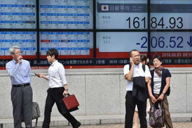Tokyo shares slip as strong yen hits exporters