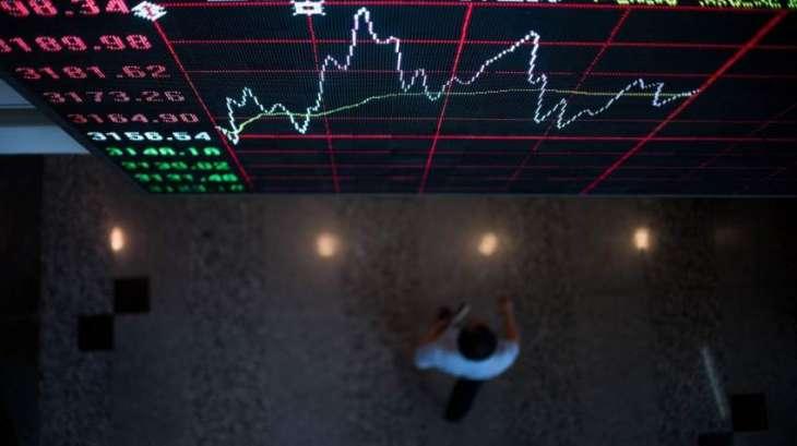 Hong Kong stocks finish up but Shanghai slips