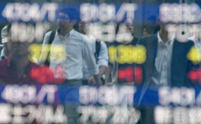 Asia stocks cautious after Fed minutes, Tokyo sinks