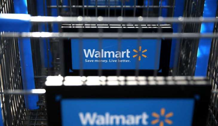 Wal-Mart boosts forecast on higher earnings; shares up