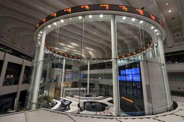 Tokyo stocks end higher on weaker yen, stronger oil