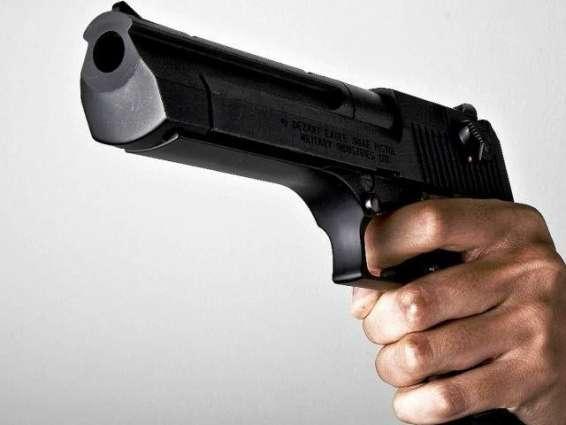 Woman gunned down