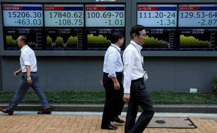Tokyo stocks open higher on weaker yen