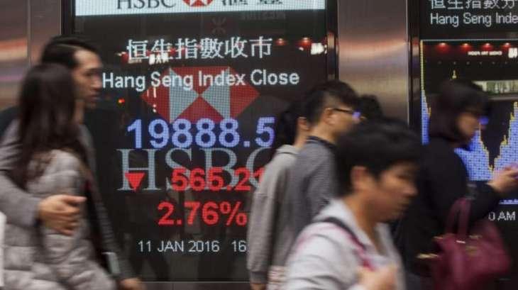 Hong Kong stocks down at lunch but Shanghai rises
