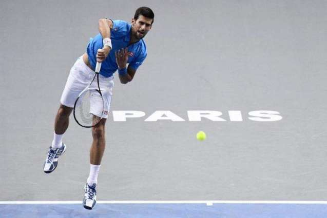 Tennis: Djokovic eases into Paris Masters last 16
