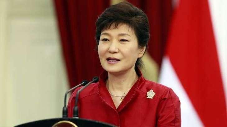 S. Korean president agrees to scandal probe, denies cult links