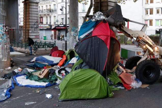 After Calais, France clears Paris migrant camp