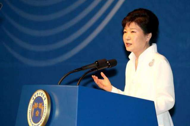 Protesters urge scandal-hit S. Korea president to quit