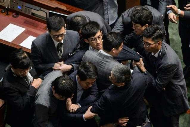Hong Kong backs China bid to bar rebel lawmakers