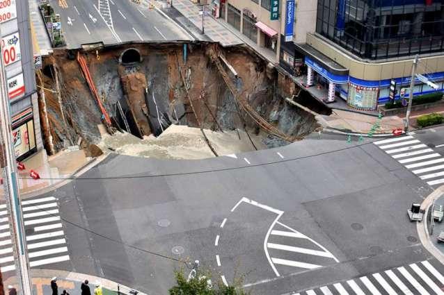 Giant sinkhole swallows Japan city street