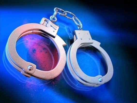10 arrested during raid on sex den